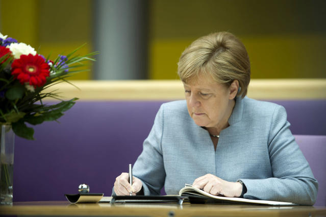 <p>German Chancellor Angela Merkel writes in a book of condolences at the British embassy on May 24, 2017 in Berlin, Germany. (Steffi Loos-Pool/Getty Images) </p>