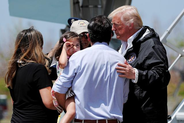 <p>President Donald Trump and first lady Melania Trump greet Puerto Rico Governor Rosselló (back to camera) and his family as they arrive aboard Air Force One, to survey hurricane damage, at Muniz Air National Guard Base in Carolina, Puerto Rico, Oct. 3, 2017. (Photo: Jonathan Ernst/Reuters) </p>