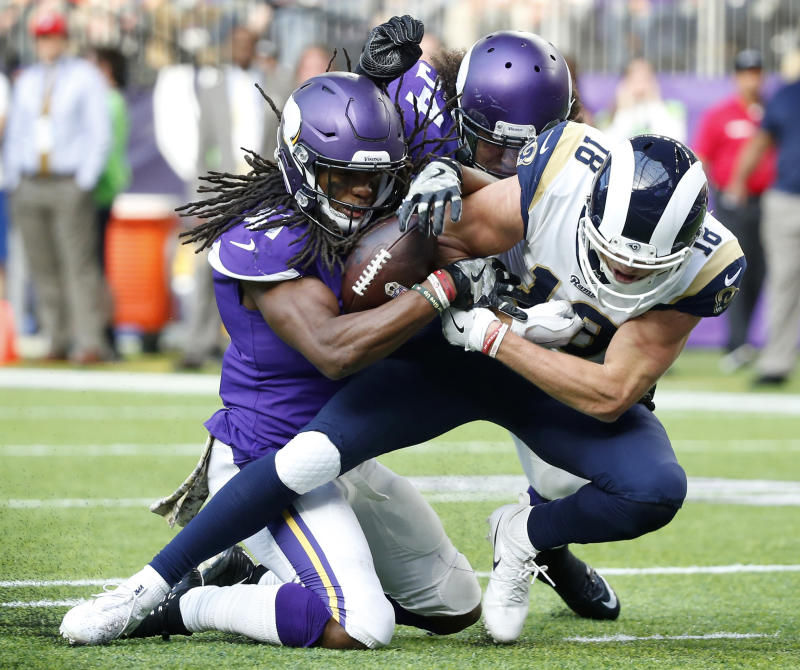 Minnesota Vikings strong safety Anthony Harris, left, strips the ball from Los Angeles Rams wide receiver Cooper Kupp. (AP)
