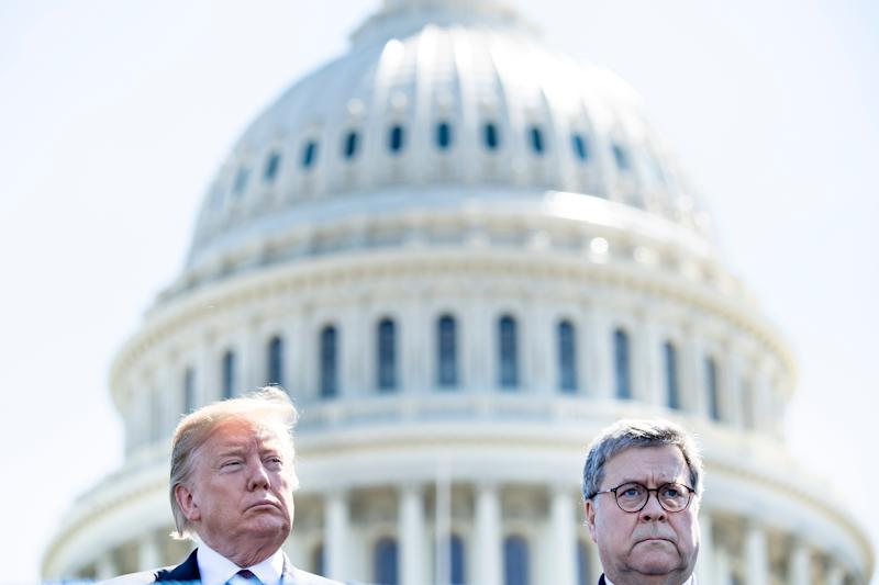 President Trump and Attorney General William Barr attend the 38th Annual National Peace Officers Memorial Service in Washington, D.C., on May 15, 2019. (Photo by Brendan Smialowski/AFP via Getty Images)