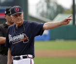 FILE - In this March 13, 2017, file photo, former MLB pitcher and Baseball Hall of Famer Phil Niekro waves to fans after he was introduced before a spring training baseball game between the Atlanta Braves and the Pittsburgh Pirates in Kissimmee, Fla. Niekro, who pitched well into his 40s with a knuckleball that baffled big league hitters for more than two decades, mostly with the Braves, has died after a long fight with cancer, the team announced Sunday, Dec. 27, 2020. He was 81. (AP Photo/John Raoux, File)