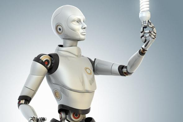 Robot holds  an energy saving lamp in his hand.