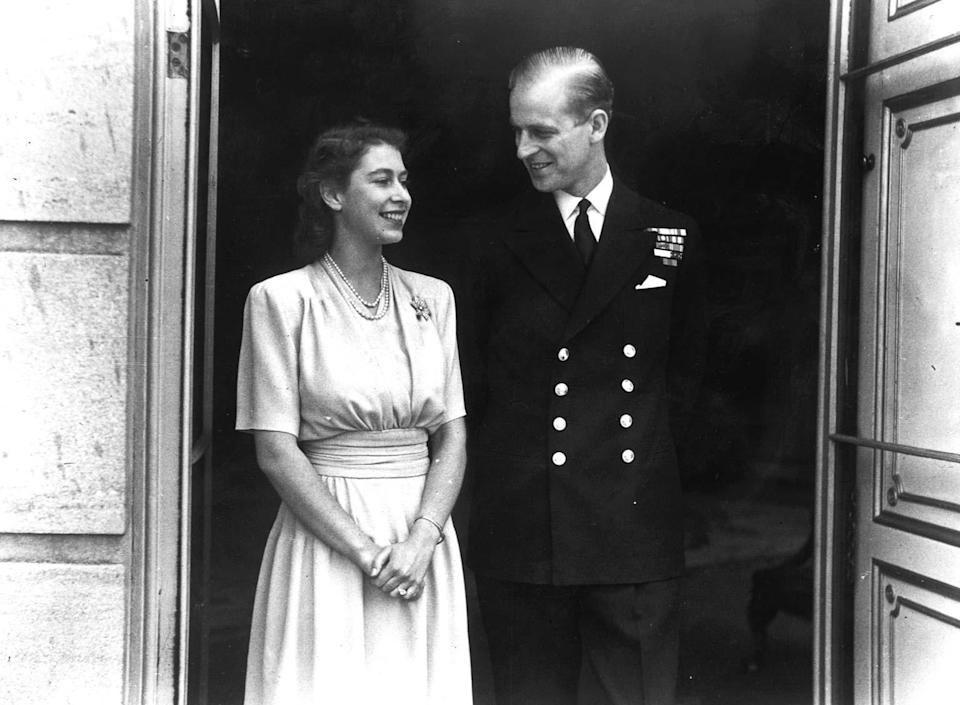 Princess Elizabeth and Lieut. Philip Mountbatten, whose engagement was announced, pose for their first engagement pictures at Buckingham Palace.