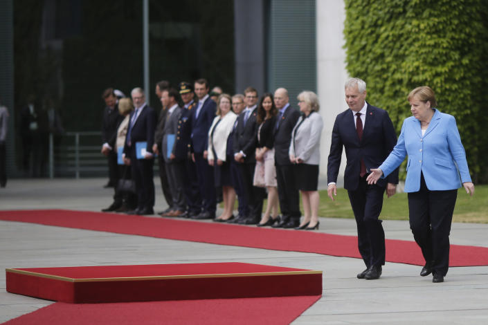 German Chancellor Angela Merkel, right, welcomes the Prime Minister of Finland Antti Rinne, second from right, for a meeting at the chancellery in Berlin, Wednesday, July 10, 2019. (AP Photo/Markus Schreiber)