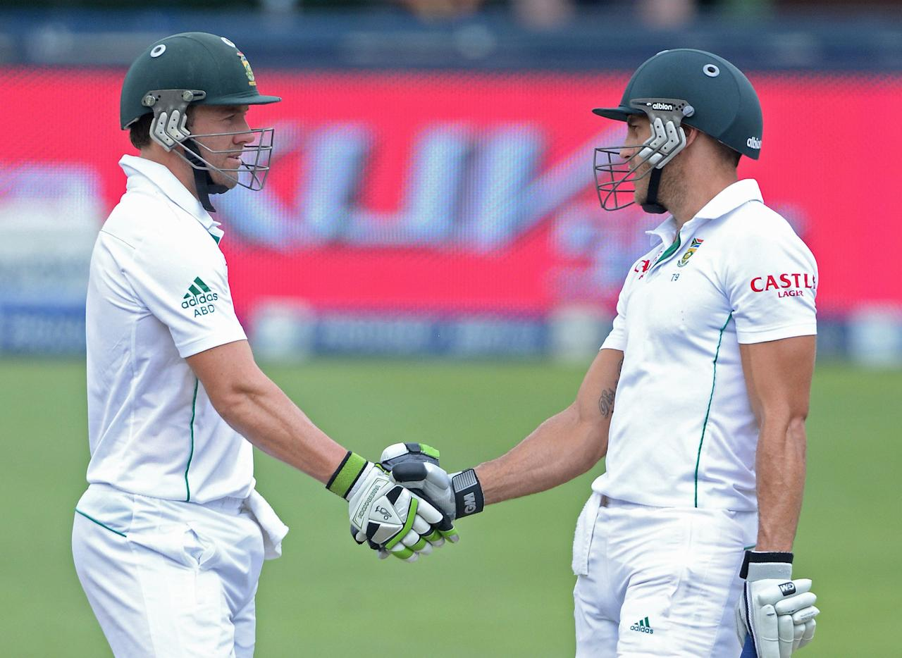 JOHANNESBURG, SOUTH AFRICA - DECEMBER 22:  Faf du Plessis (R) of South Africa celebrates his 50 with AB de Villiers during day 5 of the 1st Test match between South Africa and India at Bidvest Wanderers Stadium on December 22, 2013 in Johannesburg, South Africa. (Photo by Duif du Toit/Gallo Images)