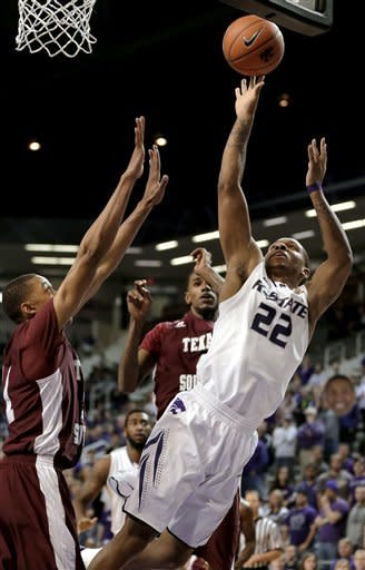 Kansas State guard Rodney McGruder (22) puts up a shot past Texas Southern guard Lawrence Johnson-Danner, left, during the first half of an NCAA college basketball game Tuesday, Dec. 18, 2012, in Manhattan, Kan. (AP Photo/Charlie Riedel)