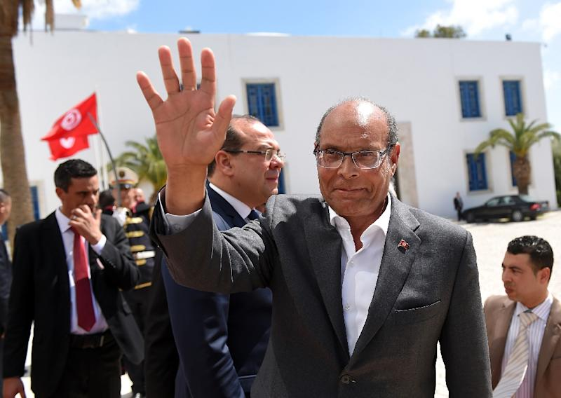 Tunisian former president Moncef Marzouki arrives to take part in an anti-extremism march, in Tunis, on March 29, 2015