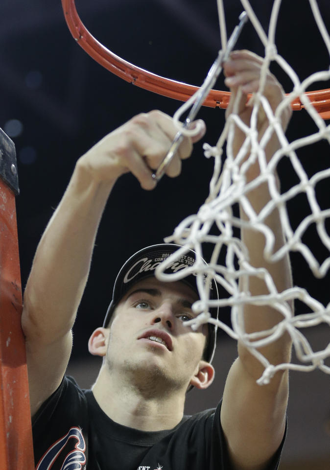 Gonzaga's David Stockton cuts down part the net after Gonzaga defeated BYU 75-64 in an NCAA college basketball game for the West Coast Conference men's tournament title, Tuesday, March 11, 2014, in Las Vegas. (AP Photo/Julie Jacobson)
