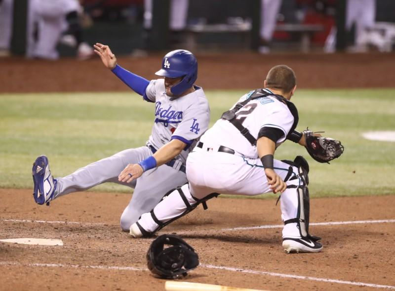MLB roundup: Dodgers rally, hang on in 10th