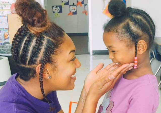 Pre-K teacher Leigh Bishop made her student smile by surprising her with an identical 'do. (Photo: Facebook/Leigh Bishop)