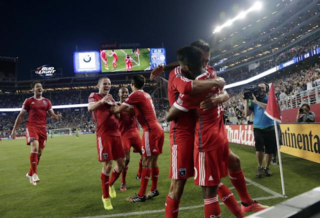 San Jose Earthquakes' Yannick Djalo, right, is hugged by teammate Chris Wondolowski after Djalo's goal against the Seattle Sounders during the first half of an MLS soccer match Saturday, Aug. 2, 2014, in Santa Clara, Calif. (AP Photo/Marcio Jose Sanchez)