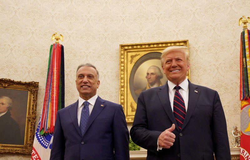 FILE PHOTO: U.S. President Donald Trump receives Iraq's Prime Minister Mustafa al-Kadhimi in the Oval Office at the White House in Washington