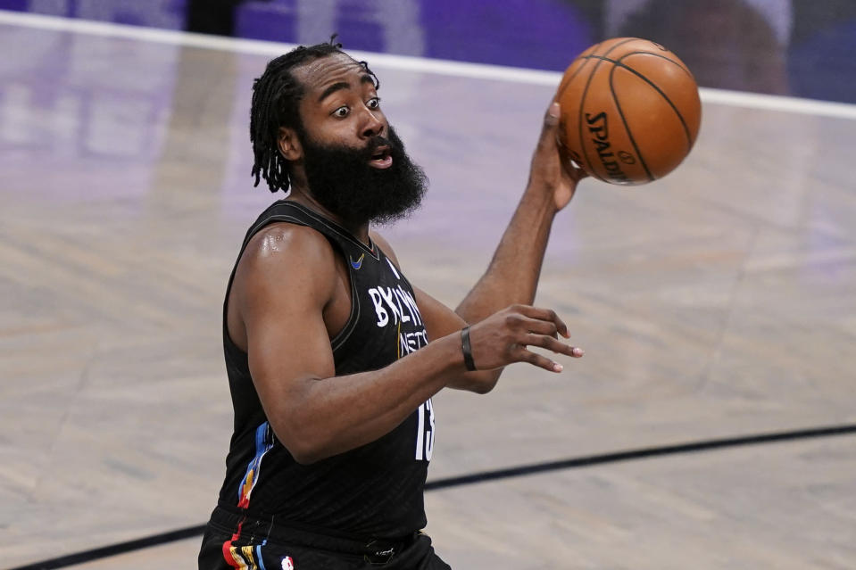 Brooklyn Nets guard James Harden (13) looks to pass the ball during the second half of the team's NBA basketball game against the Dallas Mavericks, Saturday, Feb. 27, 2021, in New York. (AP Photo/John Minchillo)