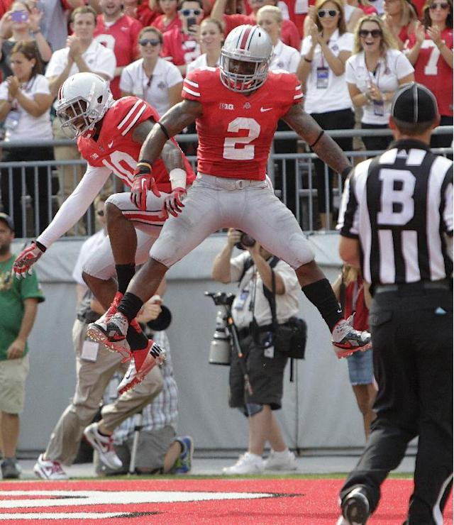 Ohio State wide receiver Corey Brown, left, celebrates his touchdown against San Diego State with teammate Jordan Hall during the first quarter of an NCAA college football game Saturday, Sept. 7, 2013, in Columbus, Ohio. (AP Photo/Jay LaPrete)