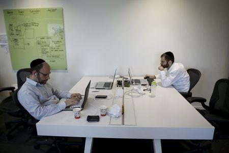 People work at Citi's tech hub in Tel Aviv, Israel December 14, 2015.  REUTERS/Amir Cohen