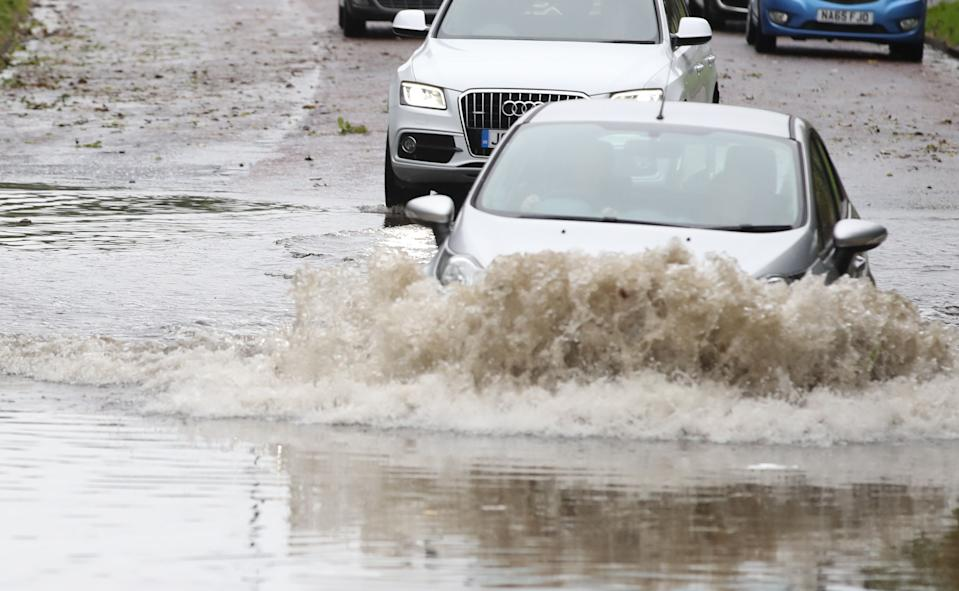 Car going through a flooded street in Whitley Bay in Northumberland. A slow-moving band of heavy rain set to drench parts of the UK has triggered weather warnings and flood alerts. (Photo by Owen Humphreys/PA Images via Getty Images)