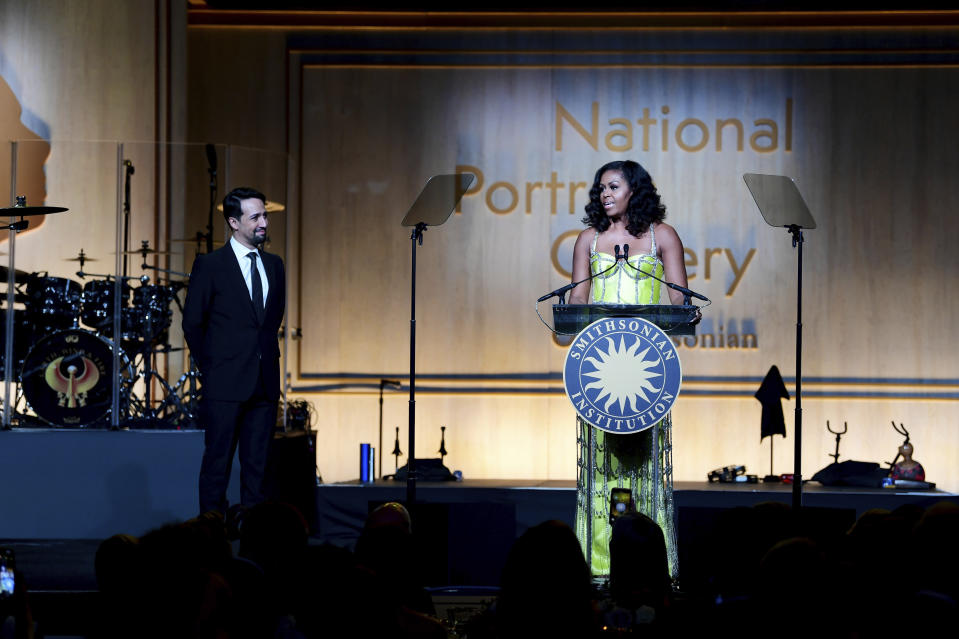 Michelle Obama awarded Lin-Manuel Miranda at the gallery. [Photo: AP]