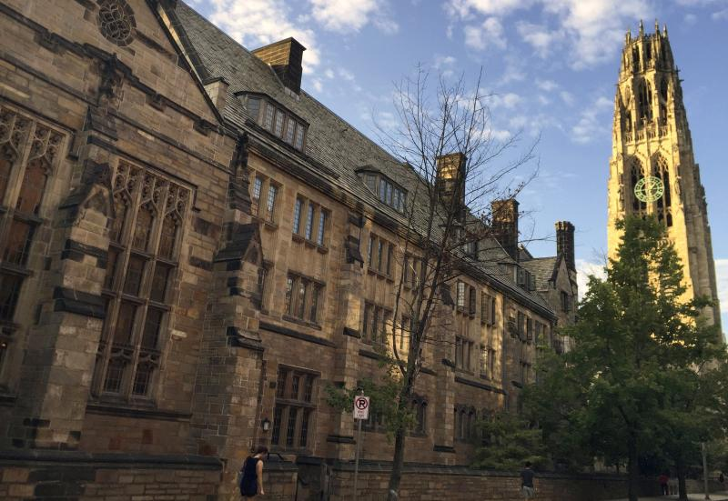 FILE - This Sept. 9, 2016 photo shows Harkness Tower on the campus of Yale University in New Haven, Conn. The U.S. Education Department said Wednesday, Feb. 12, 2020, it is investigating foreign gifts made to Harvard and Yale as part of a broader review of international money flowing to American universities. (AP Photo/Beth J. Harpaz, File)