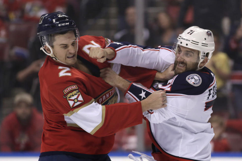 Florida Panthers defenseman Josh Brown (2) and Columbus Blue Jackets left wing Nick Foligno, right, trade blows during the first period of an NHL hockey game, Saturday, Dec. 7, 2019, in Sunrise, Fla. (AP Photo/Lynne Sladky)