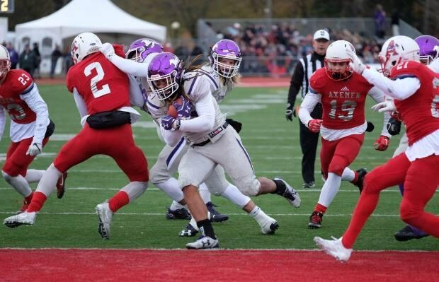 The Acadia Axemen football team is seen in action in the 2017 Uteck Bowl game against the Western Mustangs. (Ted Pritchard/Canadian Press - image credit)
