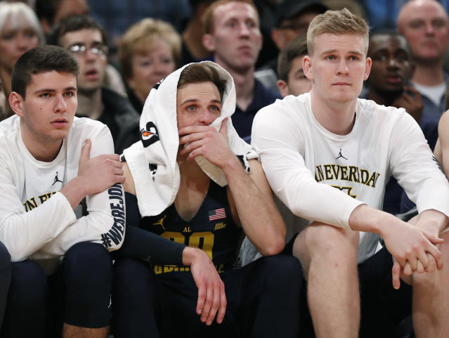 "Marquette players, including guard <a class=""link rapid-noclick-resp"" href=""/ncaab/players/121104/"" data-ylk=""slk:Andrew Rowsey"">Andrew Rowsey</a>, center, with towel over his head, watch the waning minutes of the team's NCAA college basketball game against Villanova in the Big East men's tournament quarterfinals in New York, Thursday, March 8, 2018. Villanova defeated Marquette 94-70. (AP Photo/Kathy Willens)"