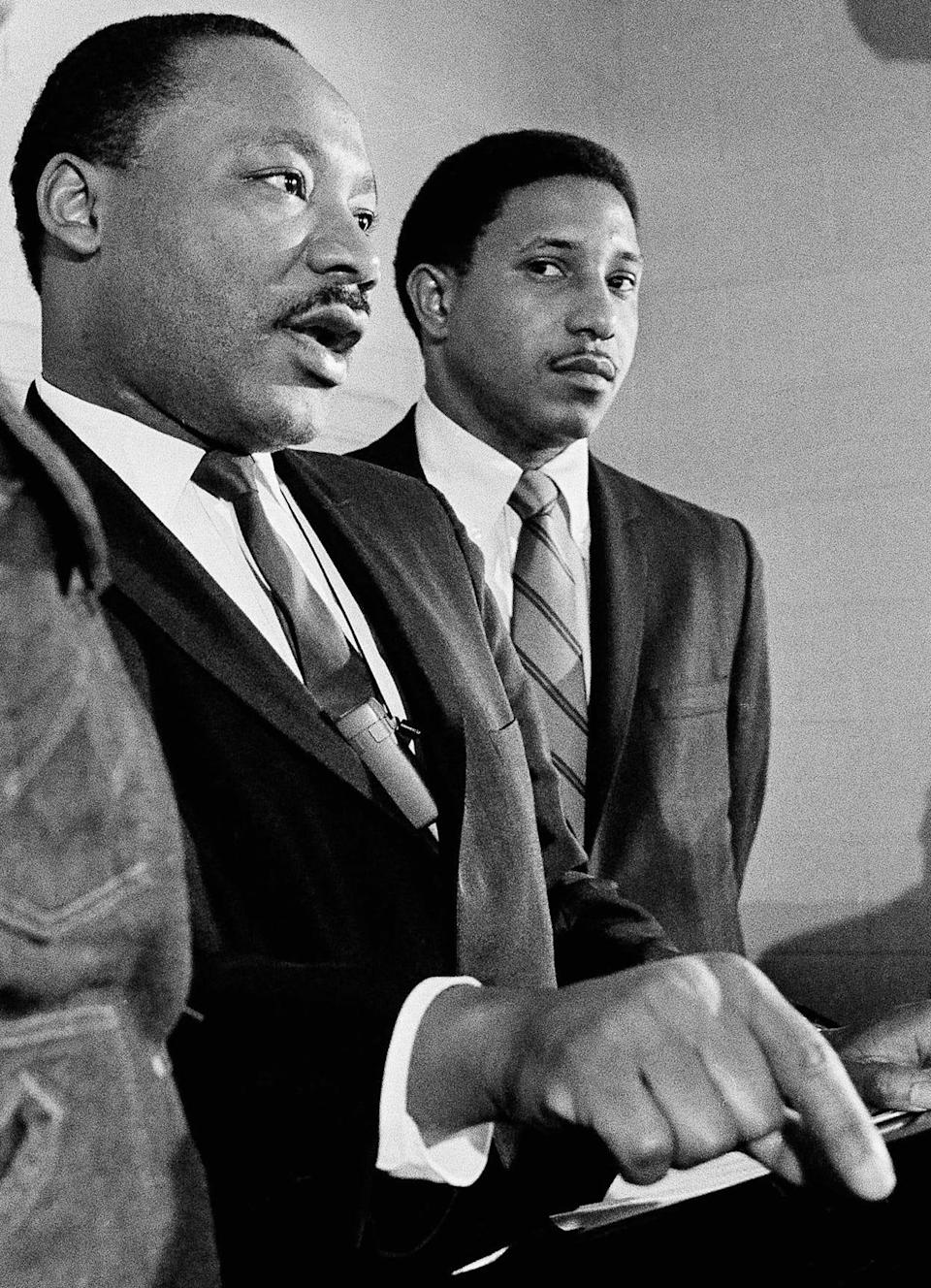 In this Tuesday, Jan. 16, 1968 file photo, Martin Luther King Jr., accompanied by the Rev. Bernard Lafayette, talks about a planned march on Washington, during a news conference in Atlanta.
