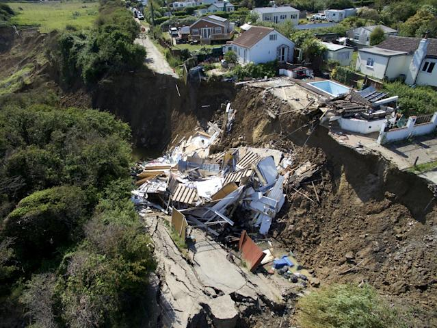 A home in Eastchurch, Kent, was destroyed after the ground gave way beneath it. (SWNS)