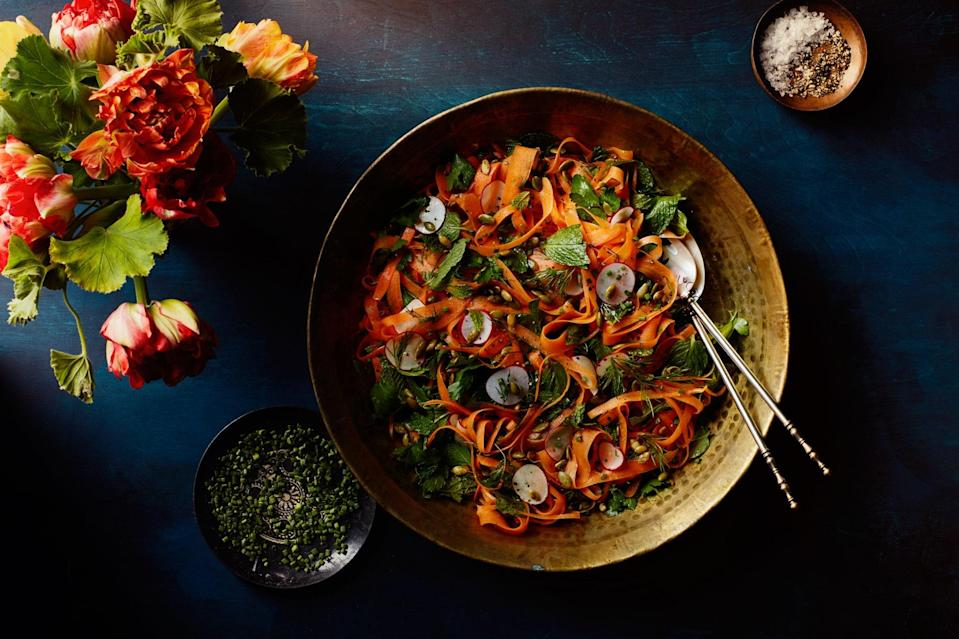 "This gorgeous tumble of bright and crisp carrot ribbons with mixed herbs (parsley, cilantro, dill, mint, tarragon, and chives all work) provides a crunchy, fresh counterpoint to any roasted meat main. <a href=""https://www.epicurious.com/recipes/food/views/shaved-carrot-and-radish-salad-with-herbs-and-pumpkin-seeds?mbid=synd_yahoo_rss"" rel=""nofollow noopener"" target=""_blank"" data-ylk=""slk:See recipe."" class=""link rapid-noclick-resp"">See recipe.</a>"