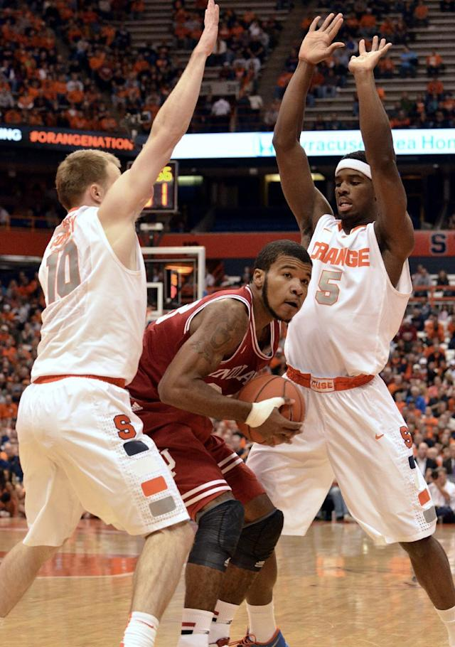 Syracuse's Trevor Cooney, left, and C. J. Fair trap Indiana's Jeremy Hollowell during the first half of an NCAA college basketball game in Syracuse, N.Y., Tuesday, Dec. 3, 2013. (AP Photo/Kevin Rivoli)