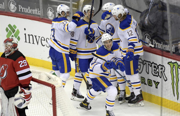 Buffalo Sabres center Dylan Cozens (24)celebrates his goal against New Jersey Devils goaltender Mackenzie Blackwood (29) during the third period of an NHL hockey game Tuesday, Feb. 23, 2021, in Newark, N.J. (AP Photo/Bill Kostroun)