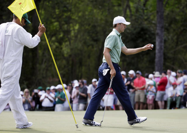 Jordan Spieth holds up his ball after a birdie on the sixth hole during the fourth round of the Masters golf tournament Sunday, April 13, 2014, in Augusta, Ga. (AP Photo/Darron Cummings)