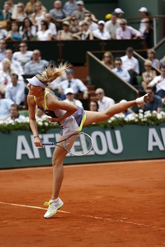 Russia's Maria Sharapova serves the ball to Belarus' Victoria Azarenka during their semifinal match of the French Open tennis tournament at the Roland Garros stadium Thursday, June 6, 2013 in Paris. (AP Photo/Petr David Josek)