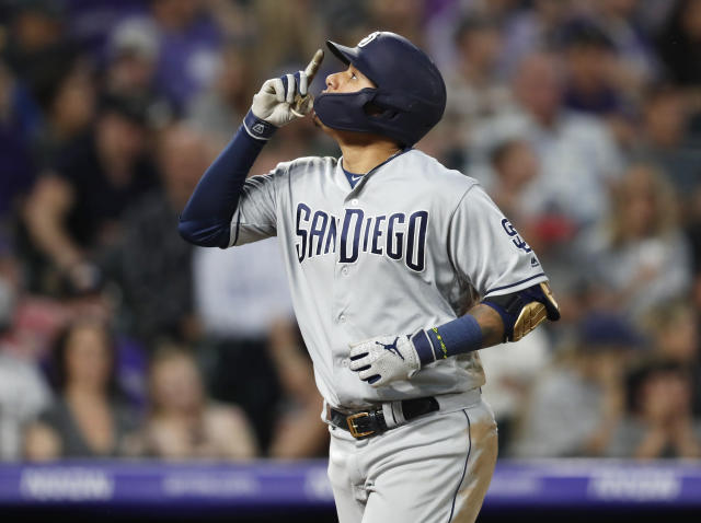San Diego Padres' Manny Machado gestures after hitting a solo home run off Colorado Rockies starting pitcher Jon Gray during the fifth inning of a baseball game Thursday, June 13, 2019, in Denver. (AP Photo/David Zalubowski)