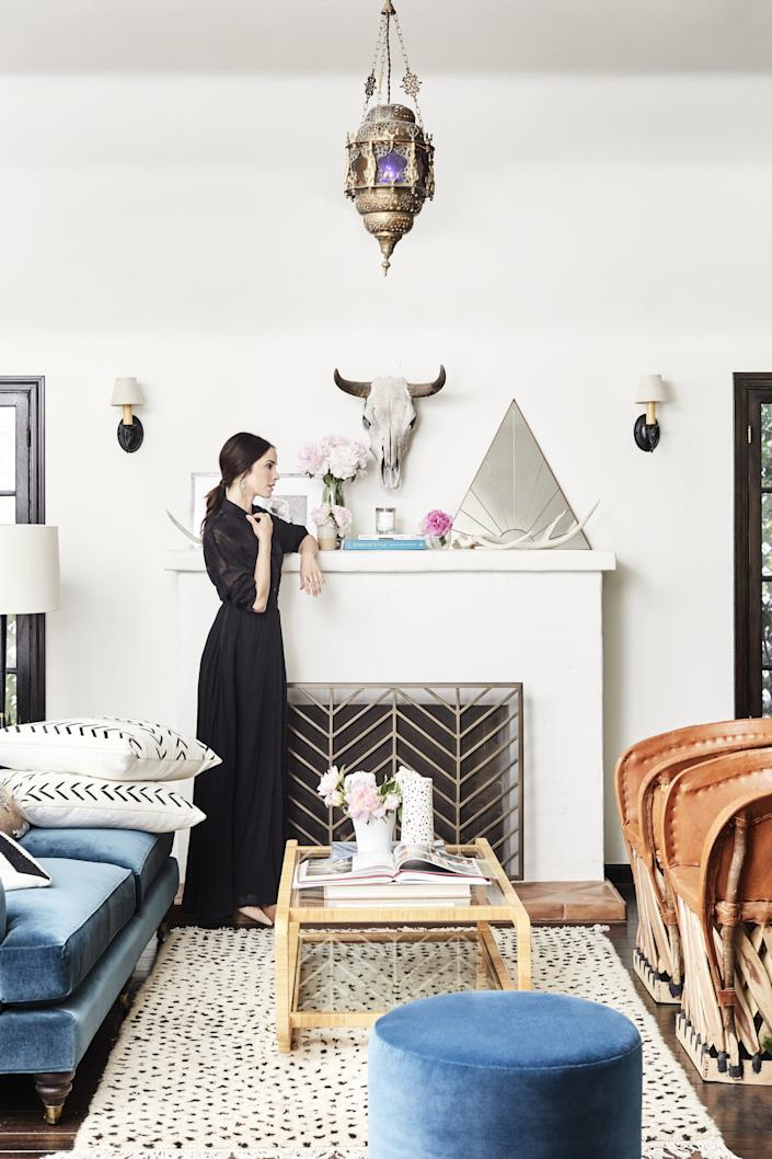 """Spencer already owned the vintage Moroccan lamp that adorns her living room. """"That just kind of fit beautifully,"""" she says."""