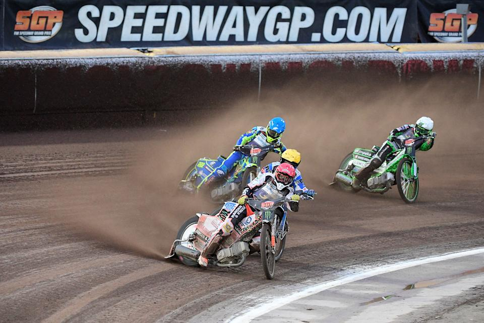 Niels-Kristian Iversen of Denmark, Leon Madsen of Denmark, Artem Laguta of Russia, and Patryk Dudek of Poland compete during the 2019 Scandinavian FIM Speedway Grand Prix, round 6, at G&B Arena on August 17, 2019, in Malilla, Sweden. (Photo by Mikael FRITZON / TT NEWS AGENCY / AFP) / Sweden OUT        (Photo credit should read MIKAEL FRITZON/AFP via Getty Images)