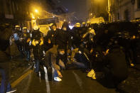 Protesters are blocked by police officers during clashes in the Belgium capital, Brussels, Wednesday, Jan. 13, 2021, at the end of a protest asking for authorities to shed light on the circumstances surrounding the death of a 23-year-old Black man who was detained by police last week in Brussels. The demonstration in downtown Brussels was largely peaceful but was marred by incidents sparked by rioters who threw projectiles at police forces and set fires before it was dispersed. (AP Photo/Francisco Seco)