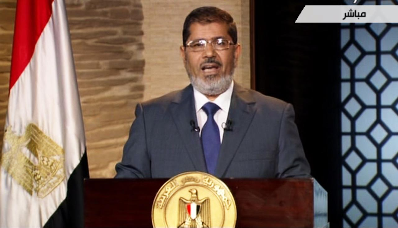 In this image taken from Egypt State TV, newly-elect President Mohammed Morsi delivers a speech in Cairo, Egypt, Sunday, June 24, 2012. Islamist Mohammed Morsi was declared the winner Sunday in Egypt's first free presidential election in history, closing the tumultuous first phase of a democratic transition and opening a new struggle with the still-dominant military rulers who recently stripped the presidency of most of its powers. (AP Photo/Egypt State TV) MANDATORY CREDIT