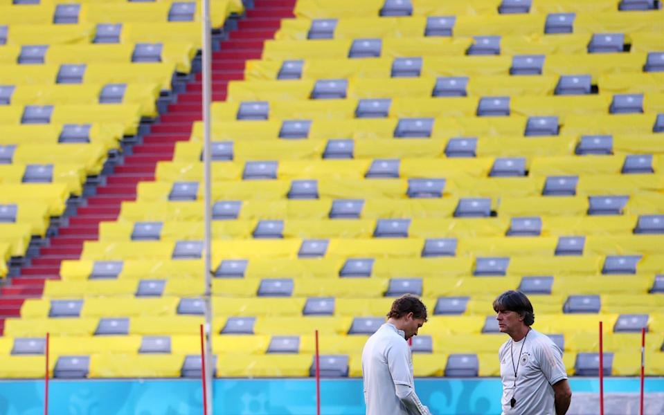 Joachim Low looks lost in thought during a training session at the Allianz Arena - REUTERS