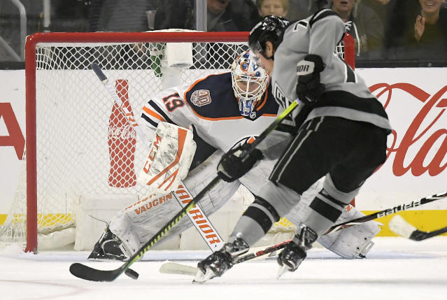 Los Angeles Kings right wing Tyler Toffoli, right, gets set to score on Edmonton Oilers goaltender Mikko Koskinen during the first period of an NHL hockey game, Saturday, Jan. 5, 2019, in Los Angeles. (AP Photo/Mark J. Terrill)
