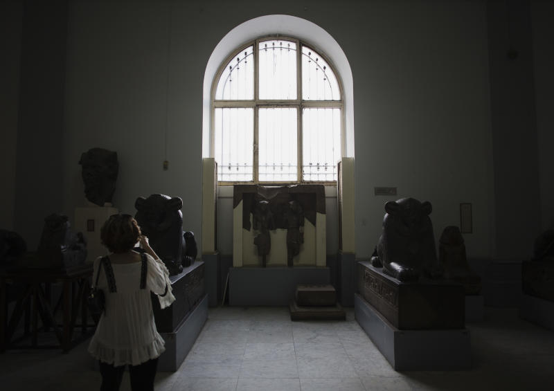 A guest takes a picture at the Egyptian Museum after its renovation project announcement in downtown Cairo, Egypt, Friday, Nov. 15, 2013. Egypt unveiled Friday an ambitious renovation project for its Cairo's famed Egyptian Museum, in a bid to show that the Arab world's most populous country was regaining a sense of normalcy after months of unrest. (AP Photo/Hiro Komae)