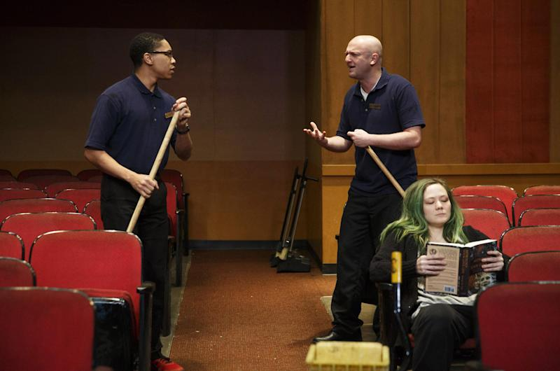 """This publicity photo released by The Publicity Office shows, from left, Aaron Clifton Moten, Matthew Maher and Louisa Krause, in a scene from Annie Baker's new play, """"The Flick,"""" premiering off-Broadway at Playwrights Horizons in New York. (AP Photo/The Publicity Office, Joan Marcus)"""