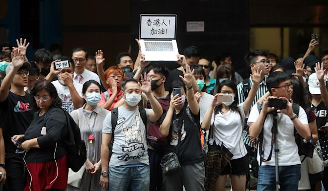 Supporters of the arrested protesters outside Eastern Court in Sai Wan Ho. Photo: Winson Wong