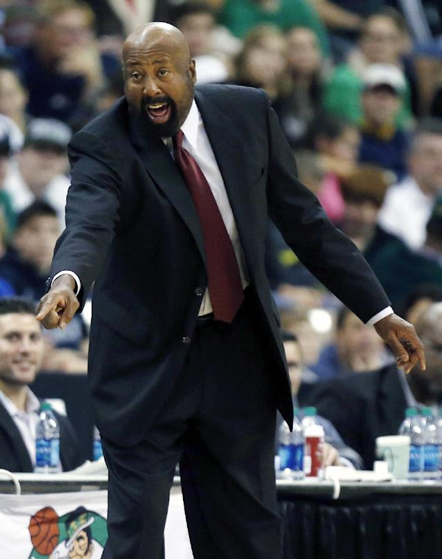 New York Knicks head coach Mike Woodson yells during the second quarter of an NBA preseason basketball game against the Boston Celtics in Manchester, N.H., Saturday, Oct. 12, 2013. The Celtics won 111-81. (AP Photo/Michael Dwyer)