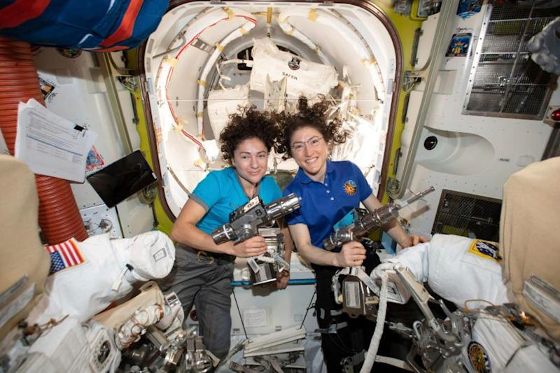 In this photo released by NASA on Thursday, Oct. 17, 2019, U.S. astronauts Jessica Meir, left, and Christina Koch pose for a photo in the International Space Station. On Friday, Oct. 18, 2019, the two are scheduled to perform a spacewalk to replace a broken battery charger.