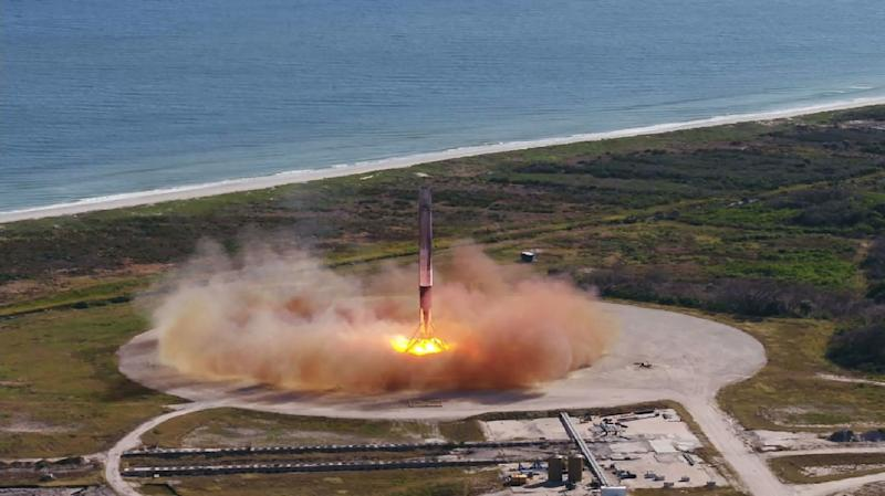 This NASA photo shows the SpaceX Falcon 9 first stage as it returned to Landing Zone 1 on December 15, 2017 in Cape Canaveral, Florida, while the Dragon cargo ship continued on to the International Space Station