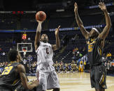 South Carolina guard Sindarius Thornwell (0) shoots against Missouri forward Jakeenan Gant (23) and Missouri forward D'Angelo Allen (5) during the second half of an NCAA college basketball game in the first round of the Southeastern Conference tournament, Wednesday, March 11, 2015, in Nashville, Tenn. South Carolina won 63-54. (AP Photo/Steve Helber)