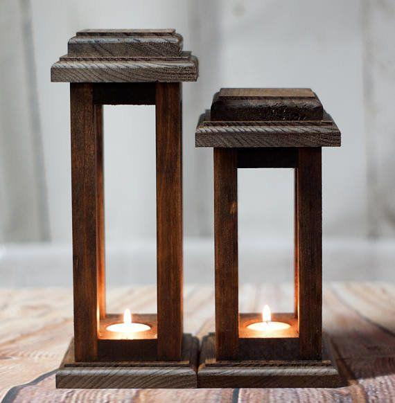 "These <a href=""https://www.etsy.com/listing/480988173/reclaimed-wood-lanterns-rustic?ga_order=most_relevant&ga_search_type=all&ga_view_type=gallery&ga_search_query=thanksgiving%20table&ref=sr_gallery_46"" target=""_blank"">wooden lanterns</a> are the perfect accessory to a simple holiday centerpiece."