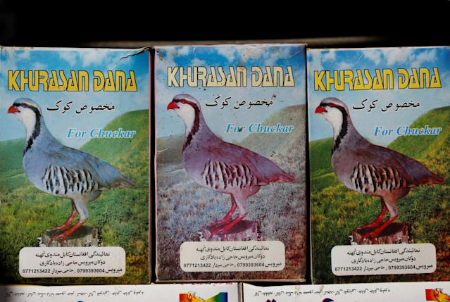 <p>Grain boxes are seen for sale in a shop at Ka Faroshi bird market in Kabul, Afghanistan, Jan. 25, 2018. (Photo: Mohammad Ismail/Reuters) </p>