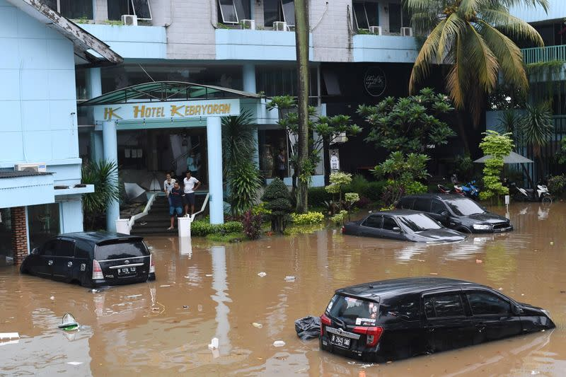 Cars are seen outside a hotel in an area affected by floods following heavy rains in Jakarta