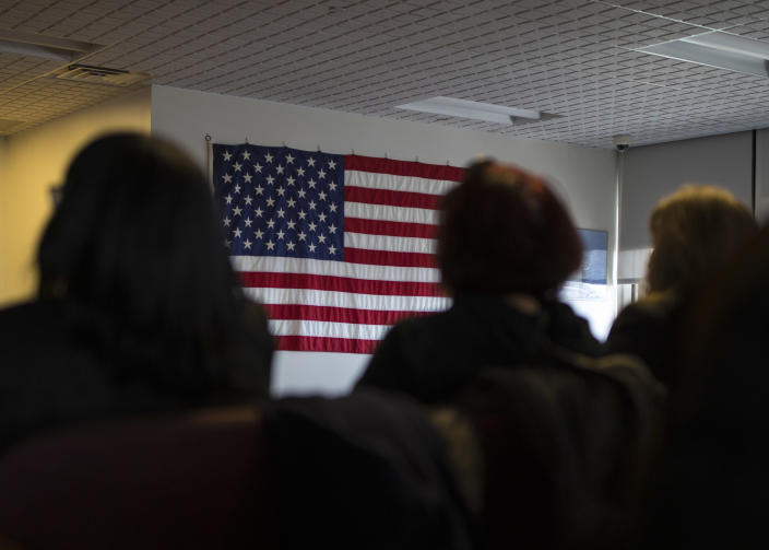 Candidates for US citizenship listen to speeches during a naturalization ceremony for new US citizens February 16, 2017 in Newark, New Jersey. Eighty-nine applicants from thirty-seven countries received their certificates of citizenship. (Robert Nickelsberg/Getty Images)
